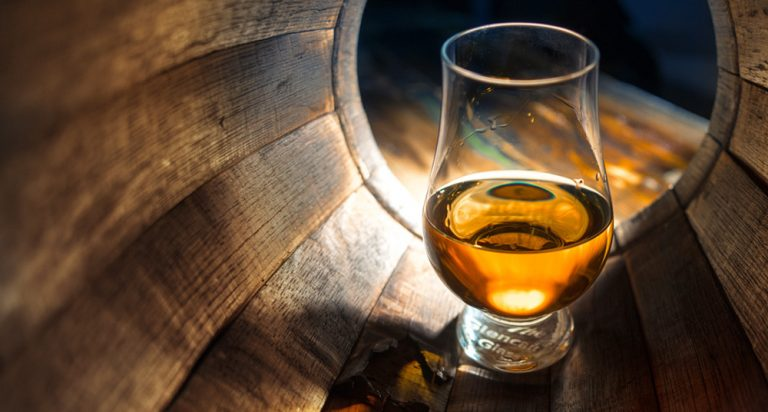 Glass of whisky in a barrel, by Art In Voyage
