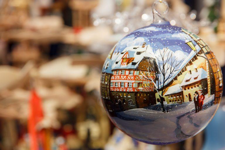 Christmas bauble depicting snowy German street, by Art In Voyage
