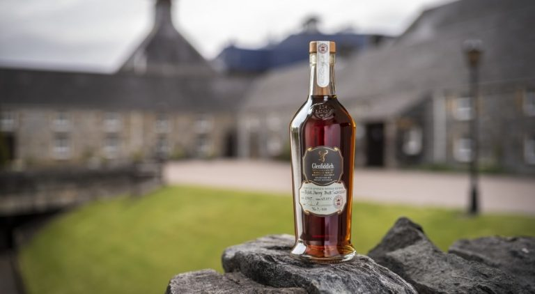 Glenfiddich whisky in front of distillery, by Art In Voyage