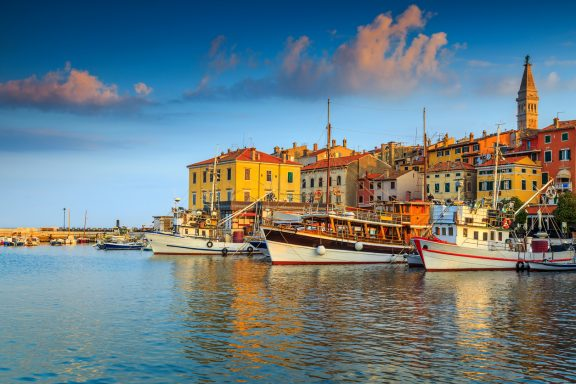 Beautiful romantic old town of Rovinj and famous fishing harbor with magical sunset,Istrian Peninsula,Croatia,Europe